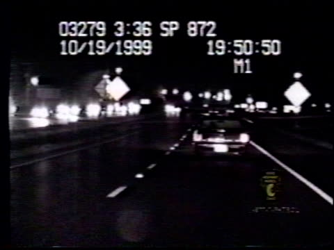 / nighttime dashcam video from police cruiser following swerving car / car crashes into back of semi truck drunk crashes into back of semi truck on... - crash stock videos & royalty-free footage
