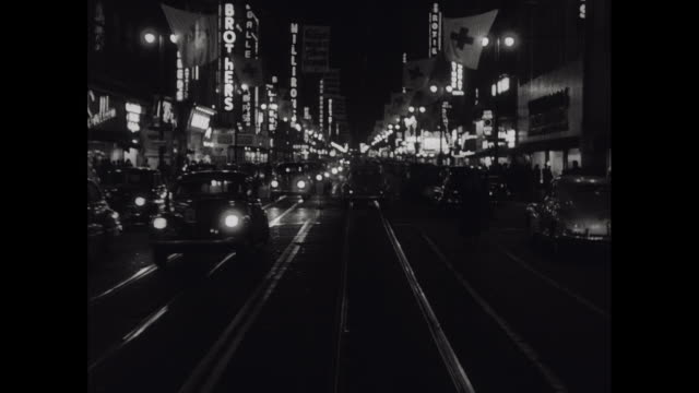 1950 nighttime pov downtown los angeles - newsreel stock videos & royalty-free footage