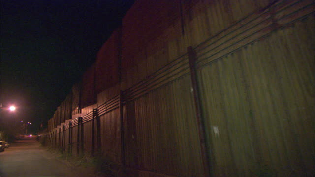 WS POV Nighttime drive along border fence / Nogales, Sonora, Mexico