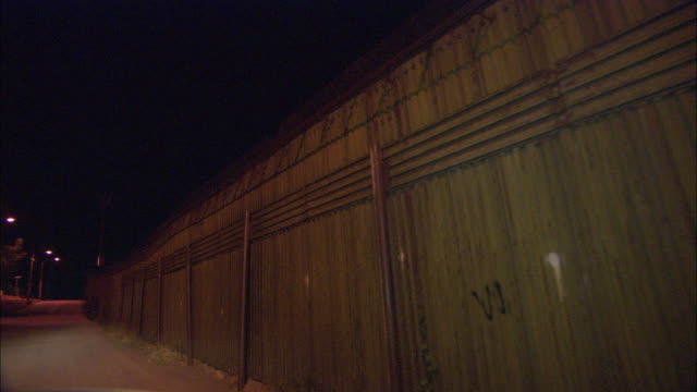 ws pov nighttime drive along border fence / nogales, sonora, mexico - geographical border stock videos & royalty-free footage