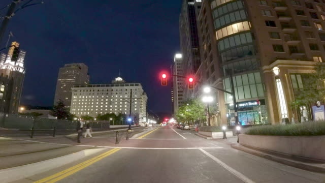 nighttime driving time lapse of downtown salt lake city utah skyscrapers - street name sign stock videos & royalty-free footage