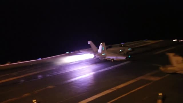 nighttime flight operations aboard the nimitzclass aircraft carrier uss abraham lincoln in the red sea may 10 2019 - afterburner stock videos and b-roll footage