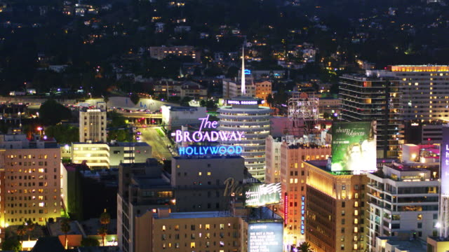 nighttime glow of hollywood & vine, los angeles - aerial shot - hollywood stock videos & royalty-free footage