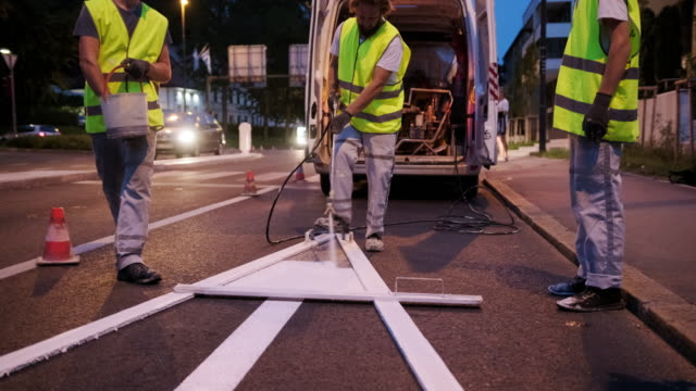 nighttime pavement marking crew spray painting turn arrow - road marking stock videos & royalty-free footage