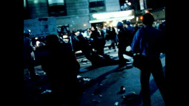 / nighttime protests at the democratic national convention / crowds of protesters moving through streets / police dragging protester through streets... - 1968 bildbanksvideor och videomaterial från bakom kulisserna