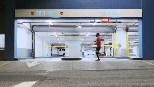 nighttime running in downtown la - multi storey stock videos & royalty-free footage