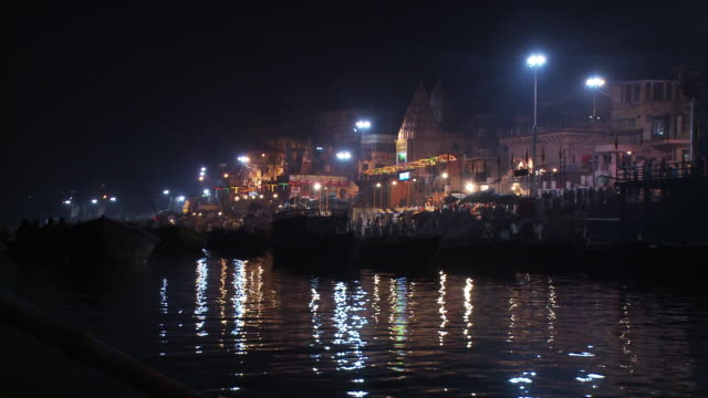 Nighttime shot of a city shoreline in India.