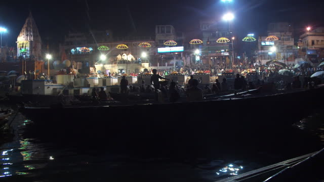 Nighttime shot of boats along the Ganges river shoreline in India.