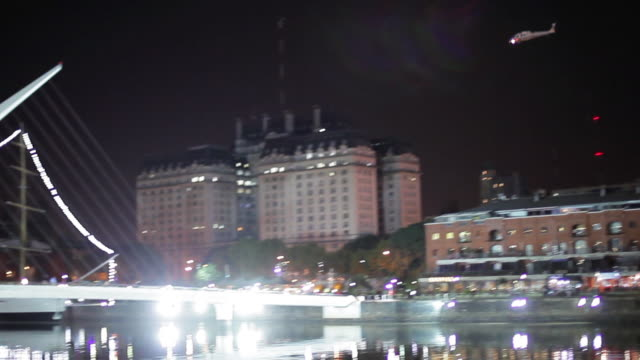 nighttime shot panning along the waterfront of puerto madero buenos aires argentina - puente de la mujer stock videos & royalty-free footage