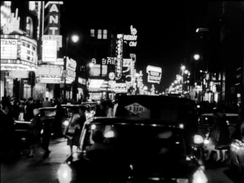 vídeos de stock, filmes e b-roll de / nighttime traveling shot in downtown montreal mostly on saint catherine street showing storefronts theatre 'loews' and cinema marquees 'les... - 1960