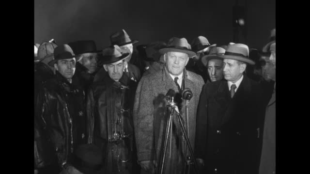 """stockvideo's en b-roll-footage met nighttime view of a crowd in fog / sot civil defense director arthur w. wallander sr. stands before microphone """"if you are seated in this theater at... - rampenoefening"""