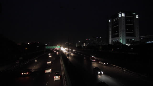 A night-view of the traffic at the National Highway 8 heading towards the national capital of Delhi