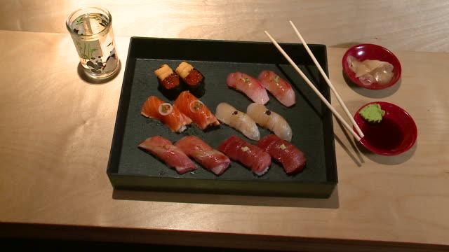 wgn nigiri platter in a sushi restaurant on march 14 2018 - nigiri stock videos and b-roll footage