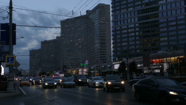 russia. moscow - 2015: 4k nigth traffic at the new arbat street - ladenschild stock-videos und b-roll-filmmaterial
