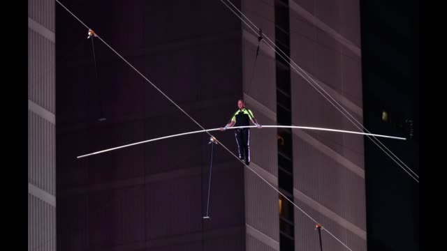 nik wallenda walks a high wire over times square during the highwire live in times square with nik wallenda on june 23 2019 in new york city - times square manhattan stock videos & royalty-free footage