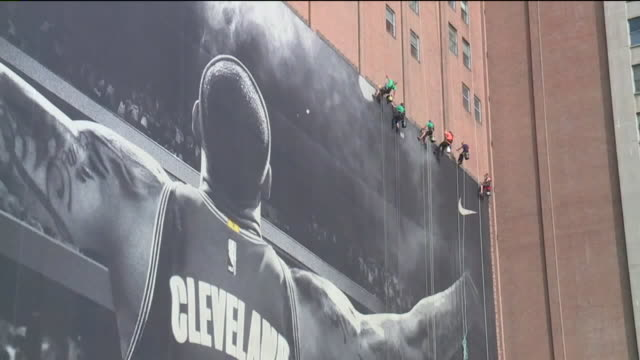 wjw nike removes lebron james banner from sherwinwilliams global headquarters wall in cleveland on july 3 2018 - cleveland ohio stock videos & royalty-free footage