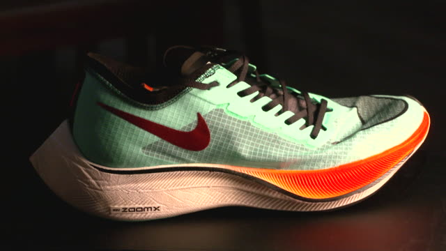 nike vaporfly running trainer criticised by some for giving professional athletes an unfair advantage - footwear stock videos & royalty-free footage