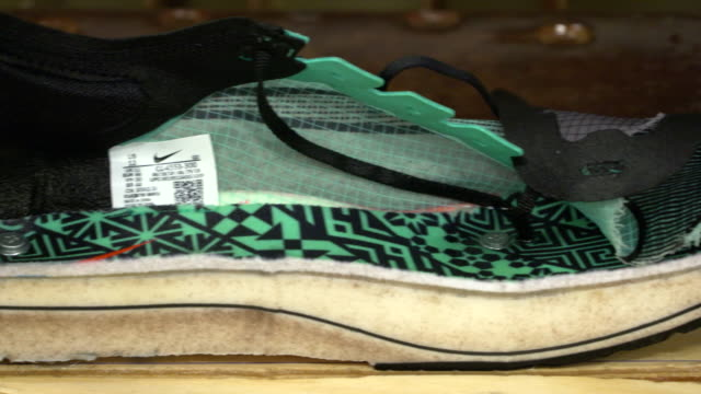 nike vaporfly running trainer cut in half to show the thick foam and carbon plate of the sole which some say give professional athletes an unfair... - thick stock videos & royalty-free footage