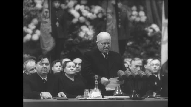 Nikita Khrushchev reads the resignation of Premier Georgy Malenkov in Russian as Malenkov sits next to him / Soviet defense minister Nikolai Bulganin...