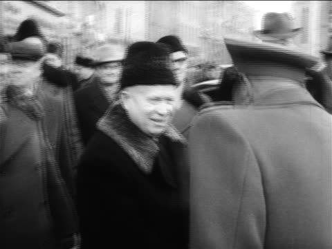 Nikita Khrushchev shaking hands with East German guard outdoors / Berlin / Germany