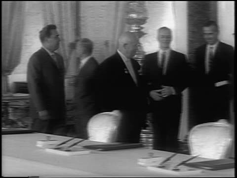 nikita khrushchev walking past diginitaries in ornate room to sign atomic test ban treaty - treaty stock videos and b-roll footage