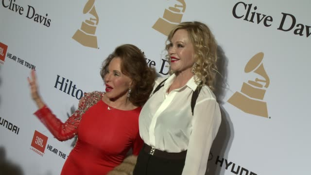 nikki haskell and melanie griffith at the pregrammy gala and salute to industry icons honoring martin bandier at the beverly hilton hotel on february... - the beverly hilton hotel stock videos & royalty-free footage