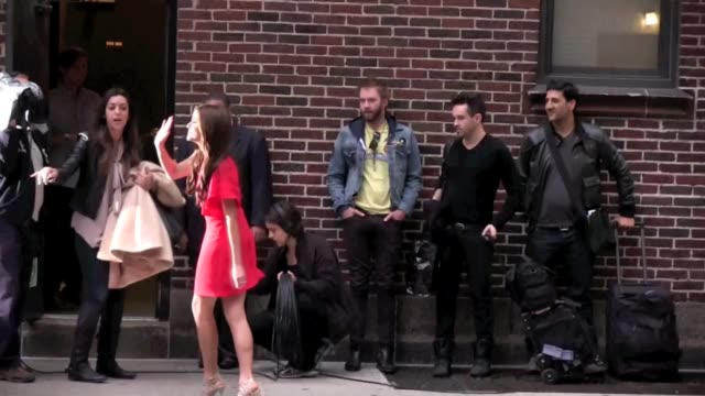 nikki reed waves to her fans as she arrives at the 'late show with david letterman' in new york 11/15/11 - nikki reed stock videos & royalty-free footage