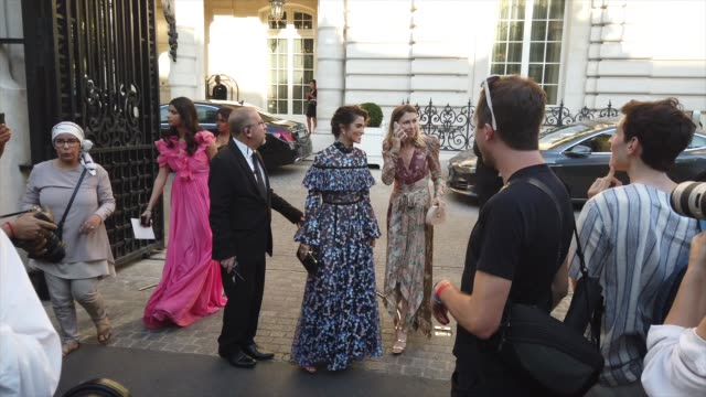 nikki reed wears a ruffled and fringed floral print mesh dress, a clutch, outside giambattista valli, during paris fashion week -haute couture... - mesh textile stock videos & royalty-free footage