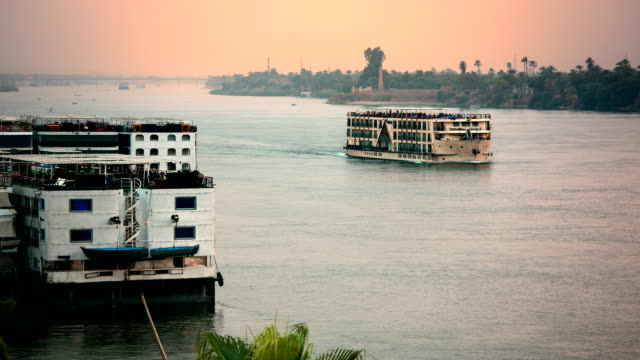Nile River cruise ship at sunset near Luxor Egypt