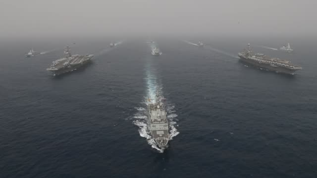 stockvideo's en b-roll-footage met nimitzclass aircraft carrier uss abraham lincoln cvn 72 the flagship of carrier strike group 12 and john c stennis cvn 74 carrier strike group 3... - amerikaanse zeemacht