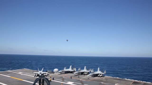 nimitz-class aircraft carrier uss abraham lincoln , flagship of carrier strike group 12 currently deployed in the atlantic ocean conducts flight... - 米国海軍点の映像素材/bロール