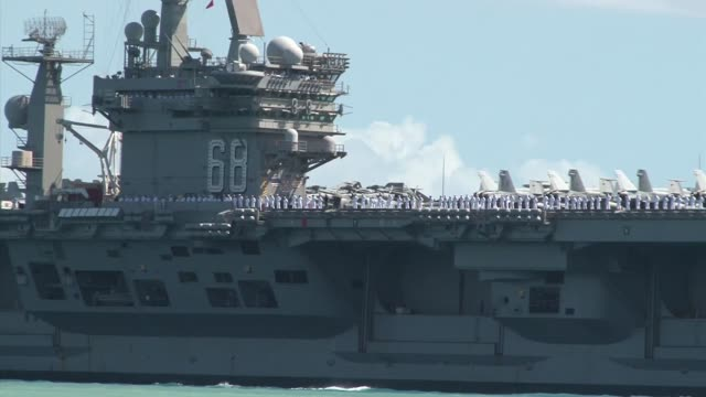 nimitz-class aircraft carrier uss nimitz transits the waters of joint base pearl harbor-hickam during the biennial rim of the pacific exercise.... - aircraft carrier stock videos & royalty-free footage