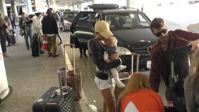 Nina Dobrev holding baby arriving at LAX Airport Celebrity Sightings on March 06 2017 in Los Angeles California