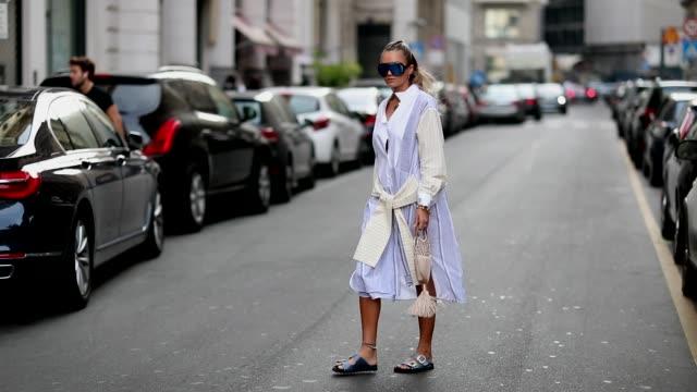 nina suess, wearing a dress, is seen outside salvatore ferragamo during milan fashion week spring/summer 2019 on september 22, 2018 in milan, italy. - salvatore ferragamo stock videos & royalty-free footage