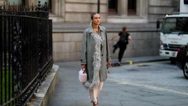 Nina Suess wearing white dress grey coat is seen outside Erdem during London Fashion Week September 2018 on September 17 2018 in London England
