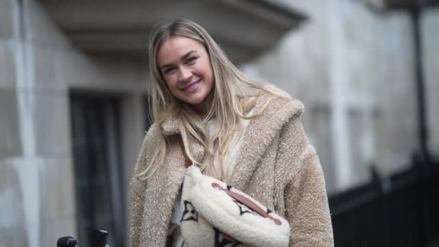 nina suess wears a fluffy faux fur coat, a fluffy vuitton fanny pack bag, white pants, boots, during london fashion week fall winter 2020 on february... - fluffy stock videos & royalty-free footage