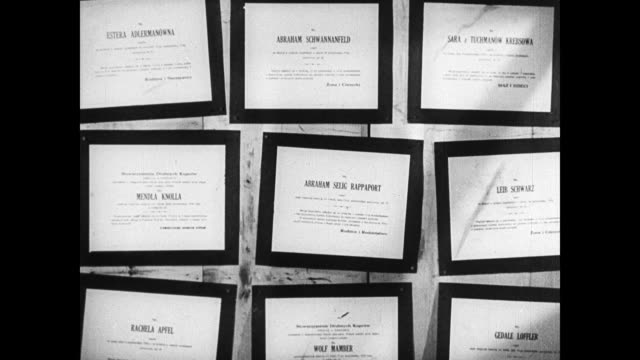 nine jewish funeral proclamations on wall jewish male pallbears carry coffin draped in black in street - ユダヤ教点の映像素材/bロール