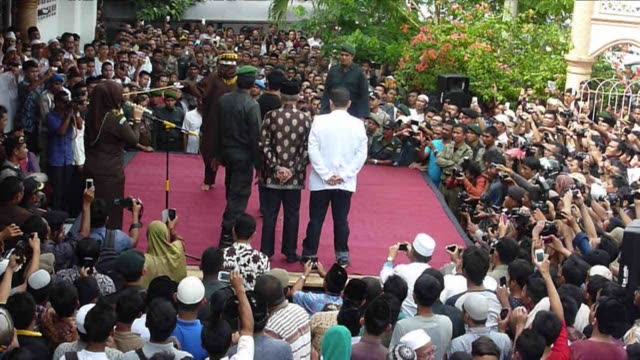 nine men were caned friday in public for gambling in the northern muslim dominated region of aceh the only province in indonesia to implement sharia... - punishment stock videos & royalty-free footage