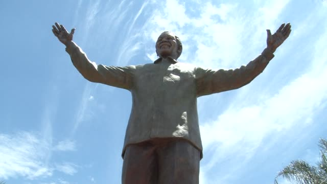 nine metre statue of nelson mandela was unveiled monday on a holiday dedicated to reconciliation, 24 hours after the solemn burial of the icon... - statue stock videos & royalty-free footage