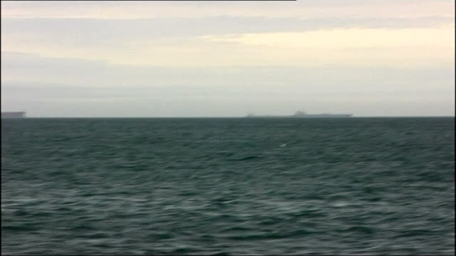 nine tankers anchor off devon coast as wait for oil prices to rise off devon coast lyme bay shots of anchored oil tankers off english coast plymouth... - anchored stock videos & royalty-free footage
