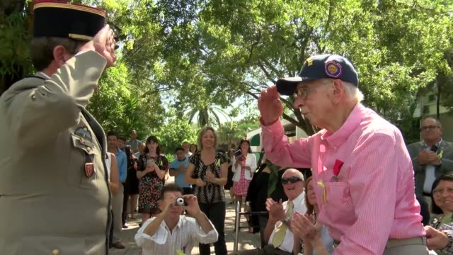 nine us veterans who fought alongside france during world war ii are awarded with the insignias of chevalier dans lordre national de la legion... - ordre stock videos and b-roll footage