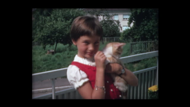 vidéos et rushes de nine year old girl with kitten - young animal