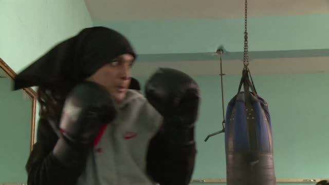 nineteen year old afghan boxer sadaf rahimi trains in the bowels of kabuls ghazi stadium dealing blows to gender stereotyping and doing her part to... - patriarchy stock videos & royalty-free footage