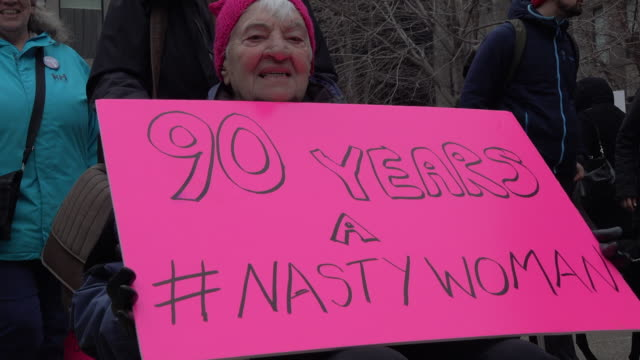 ninety years old senior protesting women and their allies marched in support of the women's march in washington toronto city saw one of the largest... - women's issues stock videos & royalty-free footage