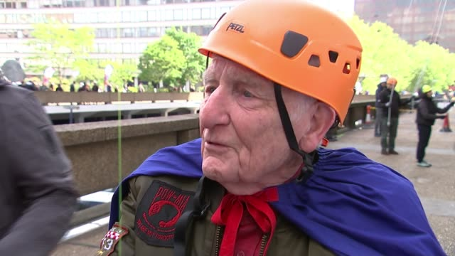 ninety-one year old abseils down st thomas' hospital; england: london: st thomas' hospital: ext frank clark interview sot cutaways clark abseiling... - abseiling stock videos & royalty-free footage