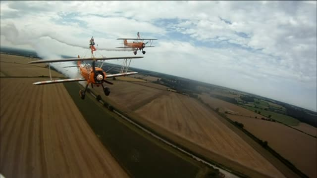 Nineyearold cousins wave midflight as they become the world's youngest wingwalkers