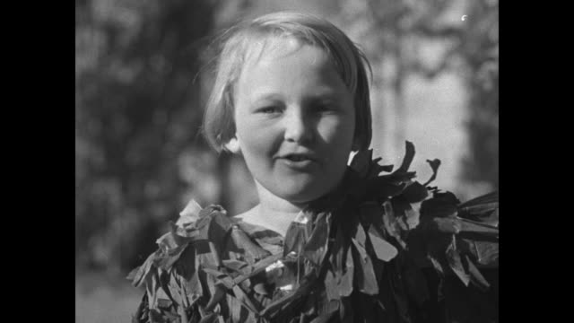 """nine-year-old kathryn skinger, dressed in feathered costume, imitates bird sounds / kathryn makes sounds of the """"cardinal red bird,"""" the """"red wing... - ハゴロモガラス点の映像素材/bロール"""