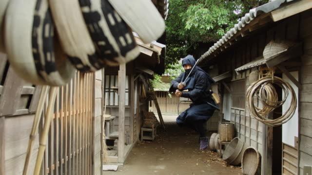 ninja posing with sword - reenactment stock videos & royalty-free footage