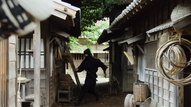 ninja running from hiding place - reenactment stock videos & royalty-free footage