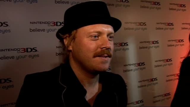 celebrity arrivals leigh francis interview sot on his omg face when he found out gaming was going 3d / what's next for gaming water squirting out the... - squirting stock videos and b-roll footage
